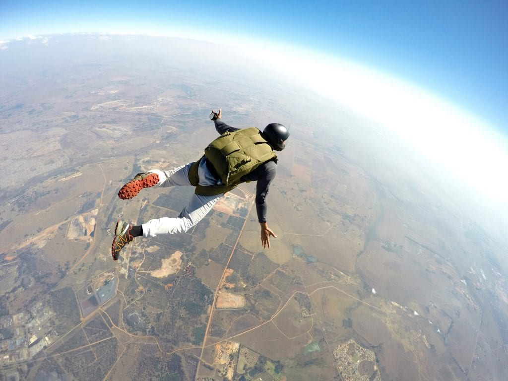 Man sky diving above earth