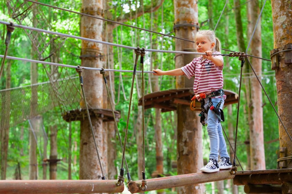 Young girl in harness at the Bali Treetop Adventure Park