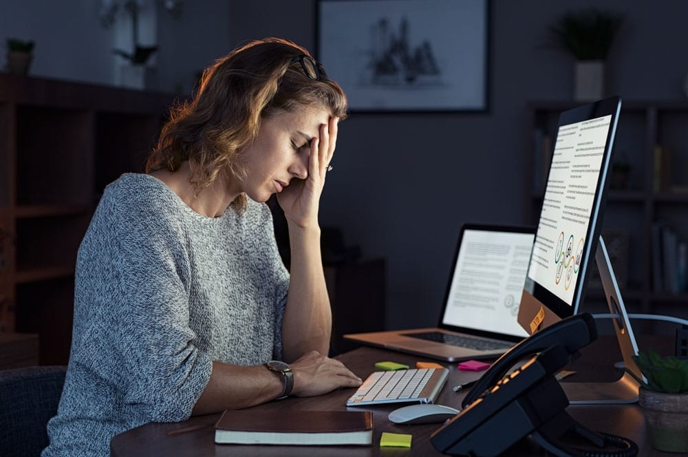 lady stressed at work at night