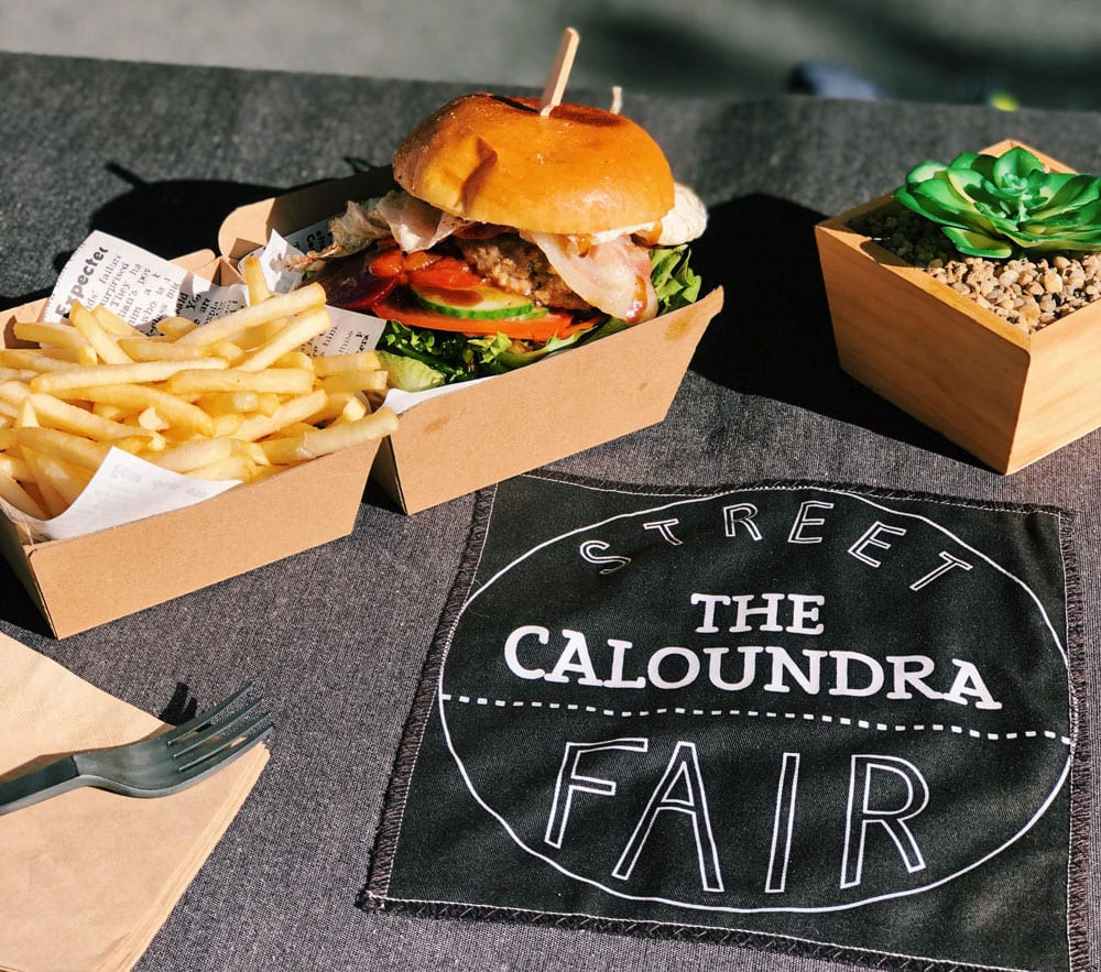 burgers and chips behind caloundra street fair logo