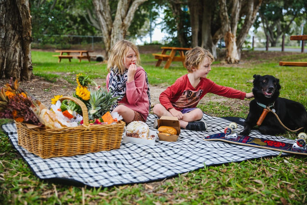 family relaxing at Markets in the Meadow