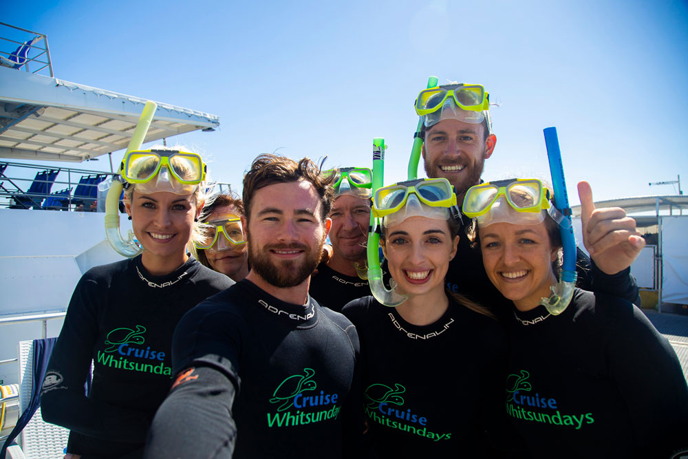 Men and women in snorkelling gear at Reefworld.