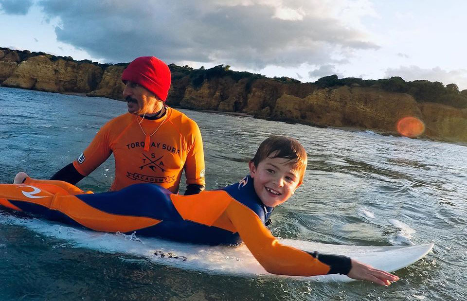 boy on surfboard in torquay