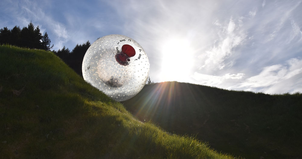 zorb rolling down hill in rotorua